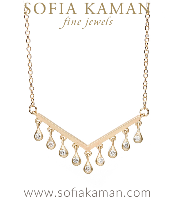 Minimal and chic, this whimsical chevron necklace is reminiscent of the chevron peaks of the Hollywood Hills or the outline left by waves on the glittering evening sand. Crafted in solid 14K gold, a smooth matte chevron centerpiece is accented with tiny diamond droplets that catch the eye and reflect light with each move you make.Petite, yet luxurious, this diamond and gold necklace is the perfect piece to elevate your favorite outfit while running to the Farmer's Market or a beautiful piece to wear out for a night with the girls. We'd pair this piece with our favorite rose cut diamond hexagon necklace for a layered look.This minimal gold necklace is set with 0.27ctw of brilliant cut diamonds and handcrafted by our artisan jewelers in Los Angeles. designed by Sofia Kaman handmade in Los Angeles using our SKFJ ethical jewelry process. This piece has been sold and is in the SK Archive.