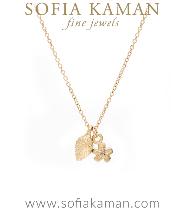 14K Gold and Diamond Leaf and Daisy Flower Charm Necklace designed by Sofia Kaman handmade in Los Angeles using our SKFJ ethical jewelry process.
