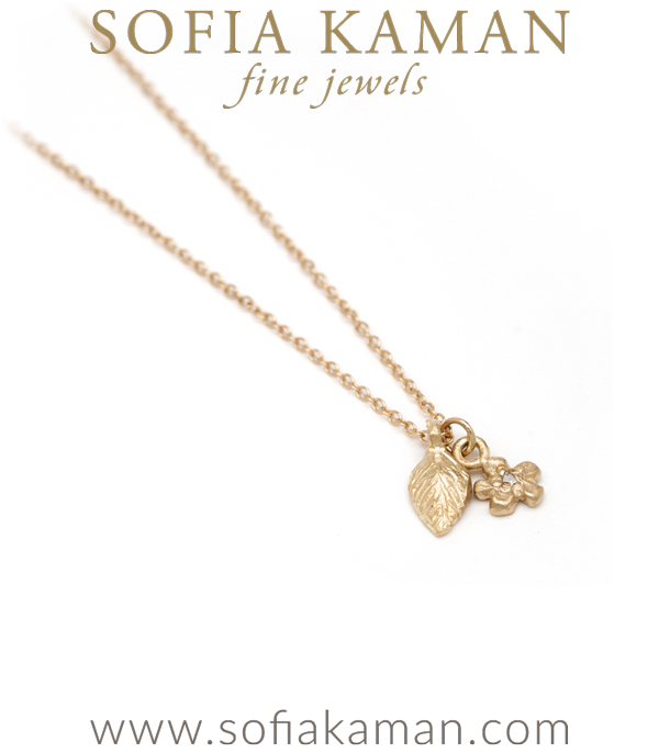 Gold Leaf And Flower Charm Necklace
