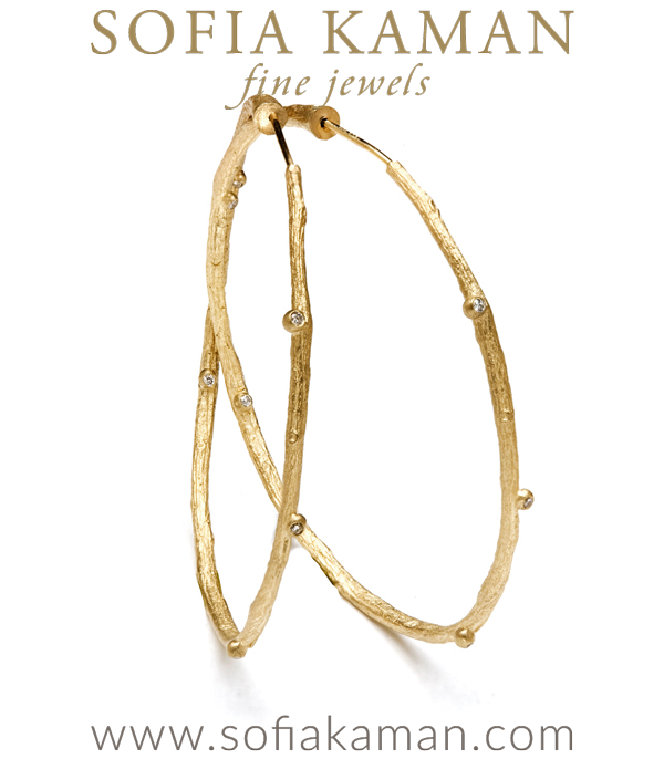 A stunning pair of 14K gold earrings. Our endless large branch-texture hoop earrings with diamond pod accents (0.10 cttw) epitomize the bohemian chic look. Hoops measure approximately 2″ in diameter. A wonderful gift for the gal who enjoys alternative jewelry that is inspired by and celebrating the beauty of nature. designed by Sofia Kaman handmade in Los Angeles
