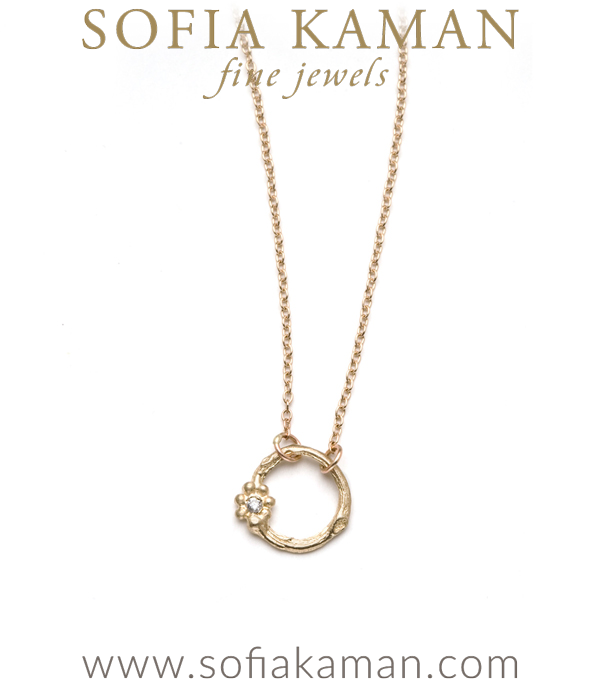"A daily reminder that good deeds go around! This small branch circle ""Karma"" necklace is set with a tiny diamond flower accent. A romantic way to pay homage to the beauty of nature. Sterling version features a blackened silver chain. Also available in solid 14k gold, 18k gold. 16″ made in Los Angeles"