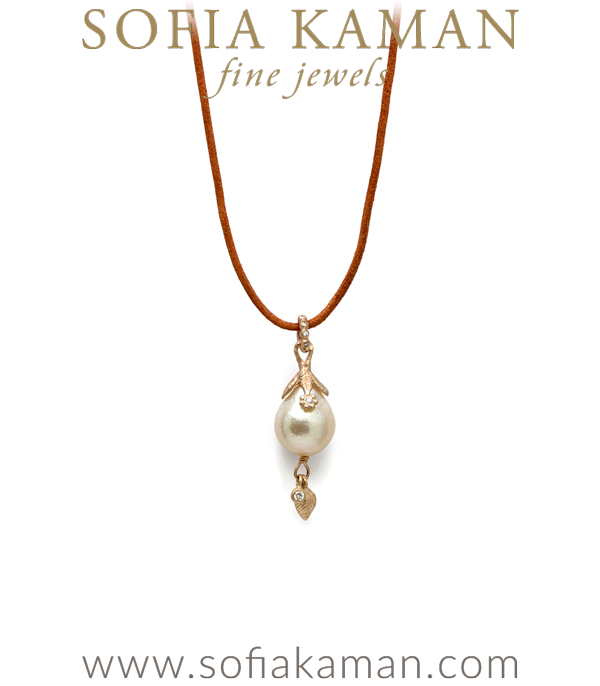 Deliciously luminous, this baroque South Sea pearl pendant is set in a diamond accented leaf cap and features a diamond bale (0.06 ctw). A dangling 14K gold leaf and diamond pod add to the charm and whimsy of this piece. Every pendant is slightly different due to the unique nature of each pearl. We love this pendant on a simple leather cord. The ultimate in beachy bohemian chic! made in Los Angeles