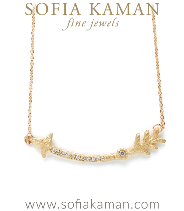 """Shoot for the moon. If you miss, you'll at least land among the stars."" We love this quote and think our latest 14K gold and diamond arrow necklace is the perfect way to express this sentiment!  A twig textured arrow set with a row of twinkling diamonds and one diamond set daisy gracefully hangs from a dainty cable chain. A gorgeous everyday piece that, also beautiful when layered with some of our other pieces from the Earth and Sky collection.Fits 18 inch designed by Sofia Kaman handmade in Los Angeles"