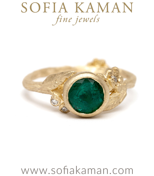 Dainty, feminine, and utterly charming! Our emerald solitaire features a 14K yellow gold twiggy textured band, diamond accented daisies and pods, and one stunning natural emerald Round Brilliant Cut center stone (approx 1ct).Crafted by our artisan jewelers in Los Angeles. designed by Sofia Kaman handmade in Los Angeles using our SKFJ ethical jewelry process.