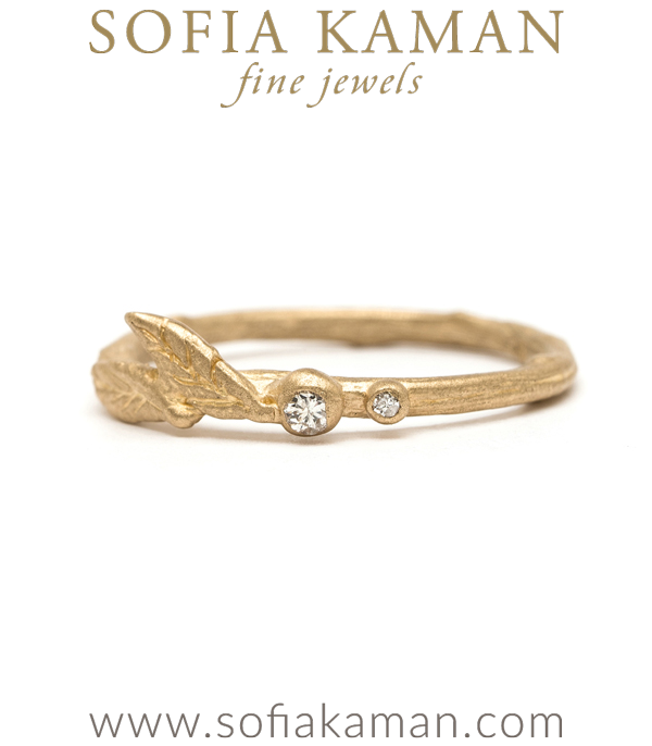 This alternate version of our Signature Leaf and Pods ring is equally enchanting! This 14K gold twig stack ring sits adorably atop most any set of rings. Two textured leaves and twinkling dew drops accented by diamonds (0.03 ctw) rise ever so slightly above the band's profile, allowing it to mix in with different styles from our Earth and Sky Collection as well as multiple other stacking rings.  A lovely gift for the romantic gal who enjoys unconventional nature inspired jewelry. This 14K solid gold and diamond stacking ring is handcrafted by our artisan jewelers in Los Angeles.Metal: 14K Yellow GoldSize: 5 designed by Sofia Kaman handmade in Los Angeles