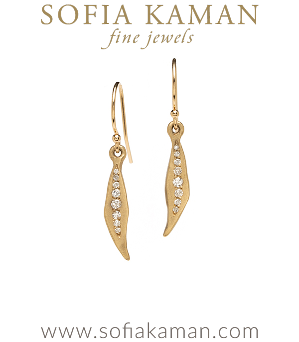 An everyday pair of dangle earrings with a touch of texture and sparkle. Dangling organic leaf shapes are set with a graduated row of pave set diamonds, and hang gracefully from diamond topped earwires (0.26 ctw). designed by Sofia Kaman handmade in Los Angeles