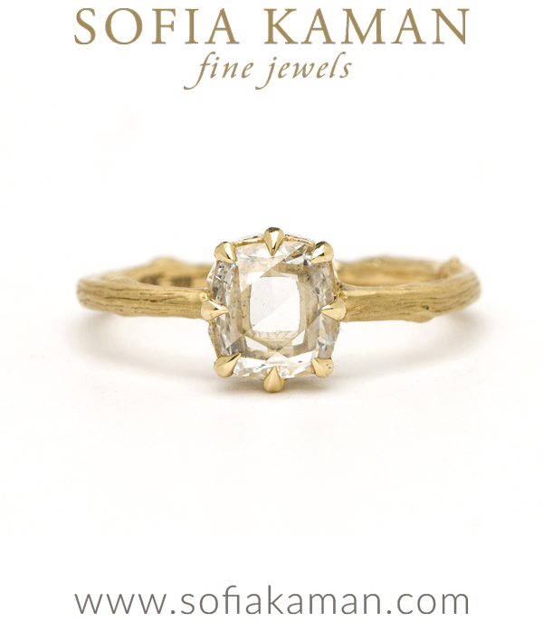 Artemis Style SK-R27, with twig band 8-prong setting	14k yellow gold, matte finish	7x5mm Oval cut Moissanite (appx 0.90ct), D-F color	No accent stones on side	size 4.75 designed by Sofia Kaman handmade in Los Angeles using our SKFJ ethical jewelry process.