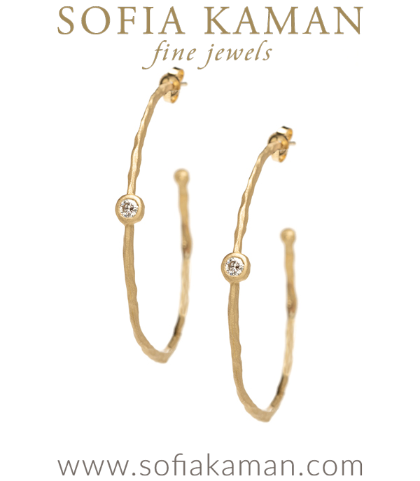 Simply perfect with a touch of drama! These large textured gold hoop earrings feature sparkling champagne rose cut diamonds set in bezels (0.20 cttw). Post backs.Approximate diameter 2 inches. made in Los Angeles