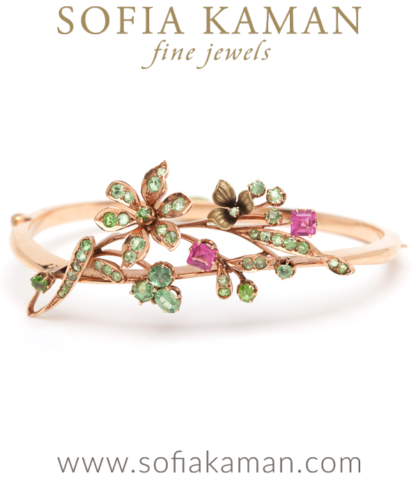 Every element comes together in perfect proportion in this whimsical Art Nouveau bracelet. This substantial 14K Vintage Art Nouveau Rose Gold Pink Sapphire Enamel Bangle Bracelet is decorated with a spray of peridot-set flowers and leaves and counter-pointed with two step cut pink sapphires. (Sapphires show slight damage to the corners.) One lightly enameled leafy accent spins along the outside edges.Fun, romantic, and beautifully executed, this Vintage Art Nouveau Rose Gold Pink Sapphire Enamel Bangle Bracelet makes any outfit, and surely creates conversation and loving eyes wherever it goes!This piece is part of our Vintage Floral edit.  See the entire collection here. curated by Sofia Kaman