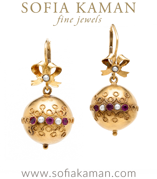 Sweet and chic, these vintage beauties are the perfect pair of earrings to wear on a festive night out or to add spice to any outfit!18K yellow gold Victorian baubles are detailed with ornate wire work, rubies and seed pearl accents.  The hollow spheres are light in weight, but full of style. We think the bow-tie detail is the icing on the cake! curated by Sofia Kaman