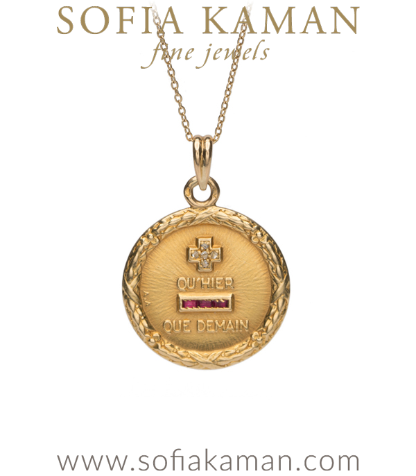 "We are in love with this iconic pendant designBased on the French poem by Rosemond Gerard. The excerpt, translated from the French,  reads ""I love you more than today, but less than tomorrow."" This beautiful sentiment is one of our favorites because it recognizes the journey that is love. This 18K pendant is highlighted with diamond and ruby accents and measures approx 7/8 of an inch across. **SOLD** designed by Sofia Kaman handmade in Los Angeles"