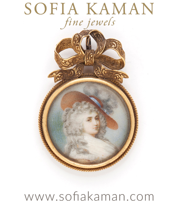 Who is this fair Lady we wonder? An ornate miniature painting on ivory or bone is framed in a gold pendant with a detailed bow a top. The reverse is engraved with 3 dates and a tiny star in center adding to the mystery! This sentimental piece is infused with history and charm. It makes a great conversation piece and adds a unique touch to any collection.18K and orange sapphire chain sold separately. curated by Sofia Kaman