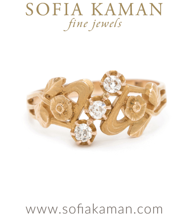 "A little reminder to stop and smell the roses, this 18k Art Nouveau ring is pure delight!  Swirling roses on each side of the band frame a diagonal row of three old mine cut diamonds. We love this ring as part of a stacked set or on its own. An ideal ring for a romantic, vintage loving bride.  Ring is hallmarked with a maker's mark . Size 7Metal: 18K yellow goldSize: 7Featured as Refinery29 | ""Vintage Engagement Rings For The Unconventional Bride""This piece is part of our Vintage Floral edit.  See the entire collection here."