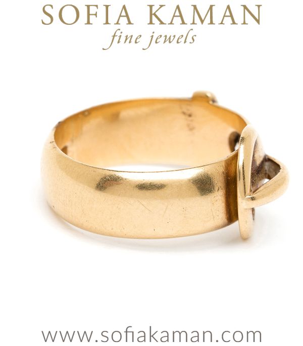 Buckle up! Our hearts race for iconic Victorian pieces, and this 18K buckle ring is a classic example. A symbol of safety, security and loyalty in Victorian times, the buckle ring was often given and worn as a symbol of binding love. A message as powerful and significant today as in times past. This Victorian ring's rounded profile and weighty substance make it as cool as it is comfortable to wear. Complete with English hallmarks, this ring dates circa 1890. Set with one Old Mine cut diamond (approx. 0.15ct).Size 5.5
